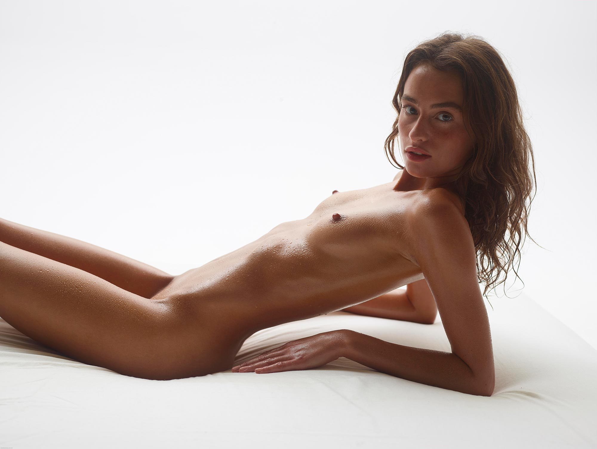 Teen nude art models get naked in a group